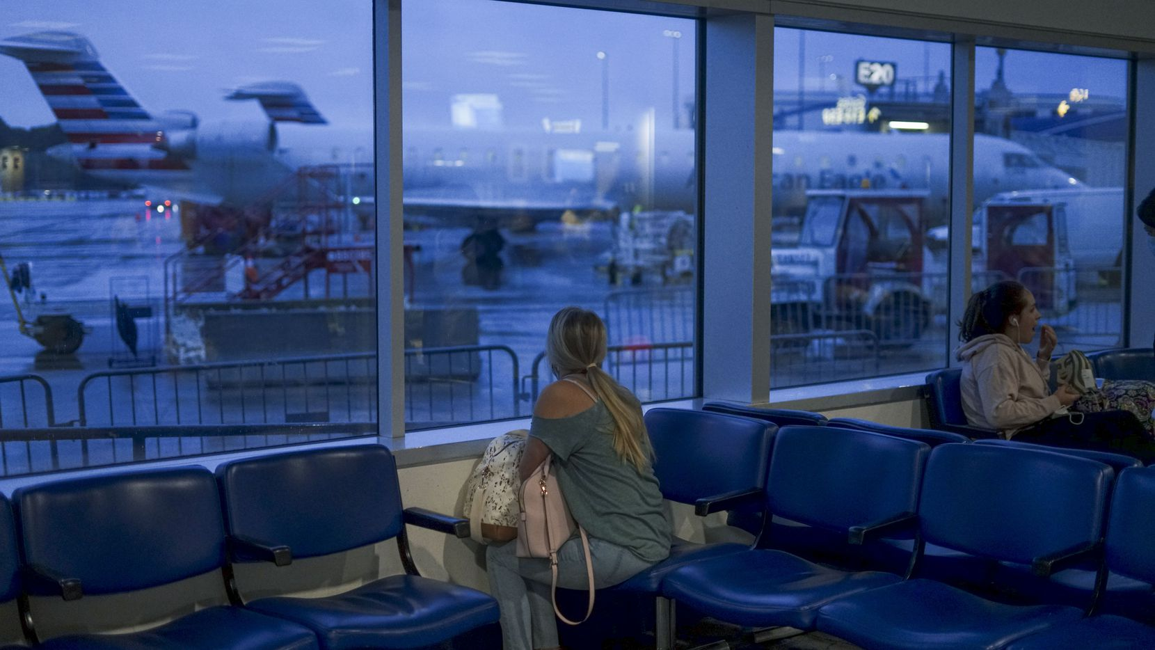 CHARLOTTE, NC - MAY 20:  A passenger waits to board an American Airlines flight to Roanoke, Virginia at Charlotte International Airport on May 20, 2020 in Charlotte, North Carolina. Air travel is down as estimated 94 percent due to the coronavirus (COVID-19) pandemic, causing U.S. airlines to take a major financial hit with losses of $350 million to $400 million a day as nearly half of major carriers' planes sit idle. (Photo by Sandy Huffaker/Getty Images)
