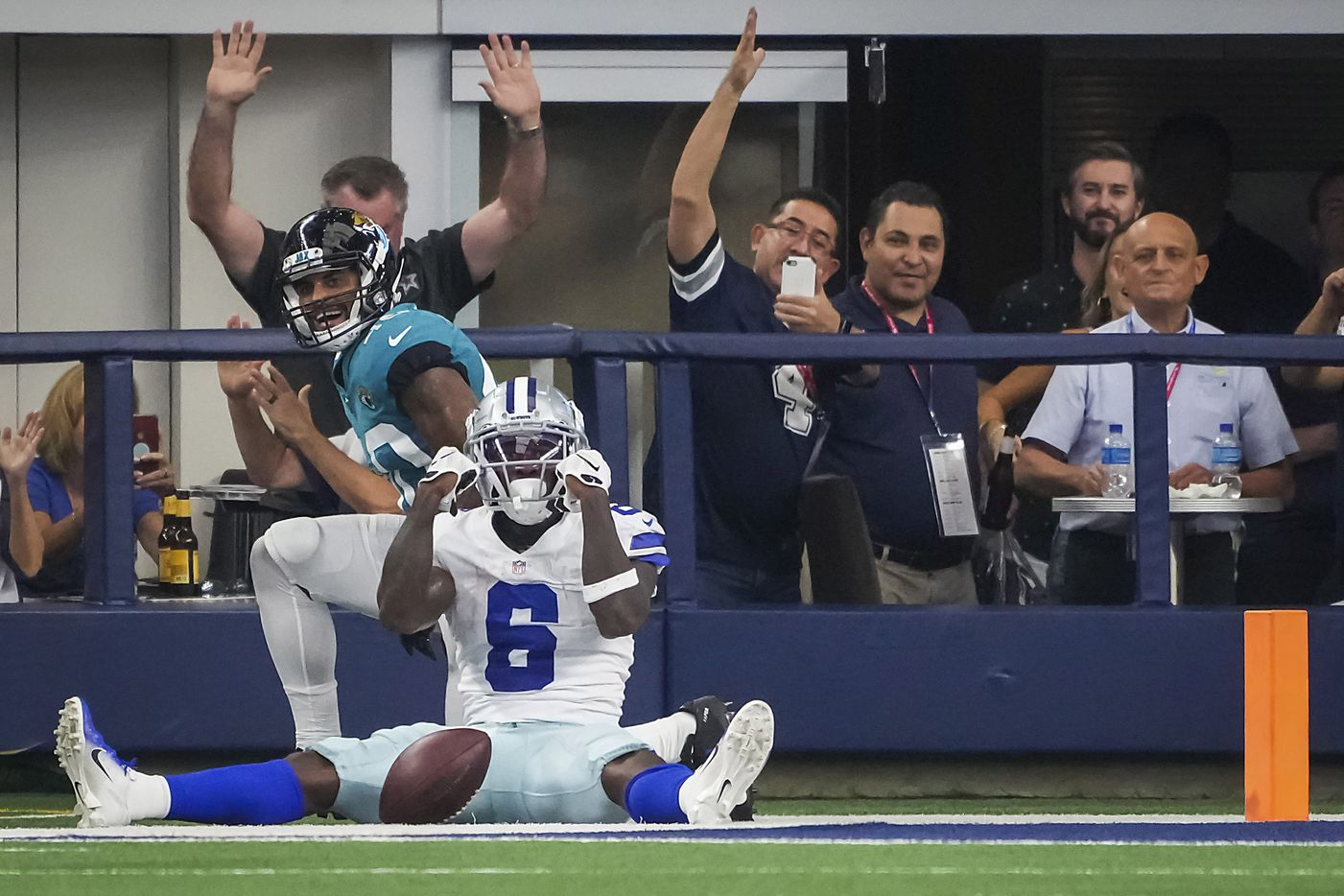 Dallas Cowboys wide receiver Johnnie Dixon (6) celebrates after catching a touchdown pass past Jacksonville Jaguars defensive back Brandon Rusnak (40) during the second half of a preseason NFL football game at AT&T Stadium on Sunday, Aug. 29, 2021, in Arlington. (Smiley N. Pool/The Dallas Morning News)