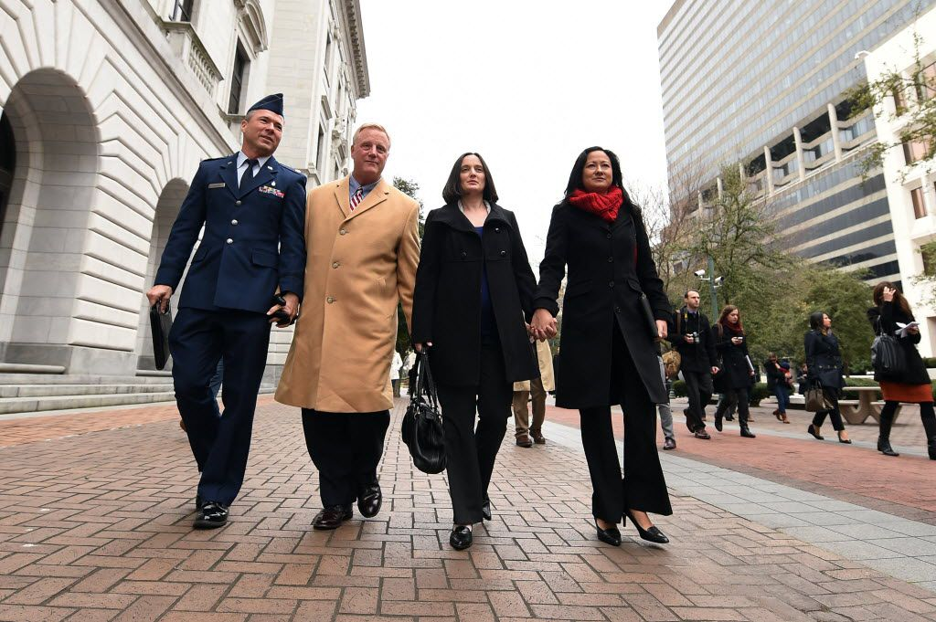 Plaintiffs Vic Holmes (from left), Mark Phariss, Nicole Dimetman and Cleopatra DeLeon walk outside of the 5th U.S. Circuit Court of Appeals Building on Jan. 9, 2015, in New Orleans. Opponents and supporters of gay marriage argued their sides before the 5th U.S. Circuit Court of Appeals, on gay marriage bans in Texas, Louisiana and Mississippi . (AP Photo/Stacy Revere)