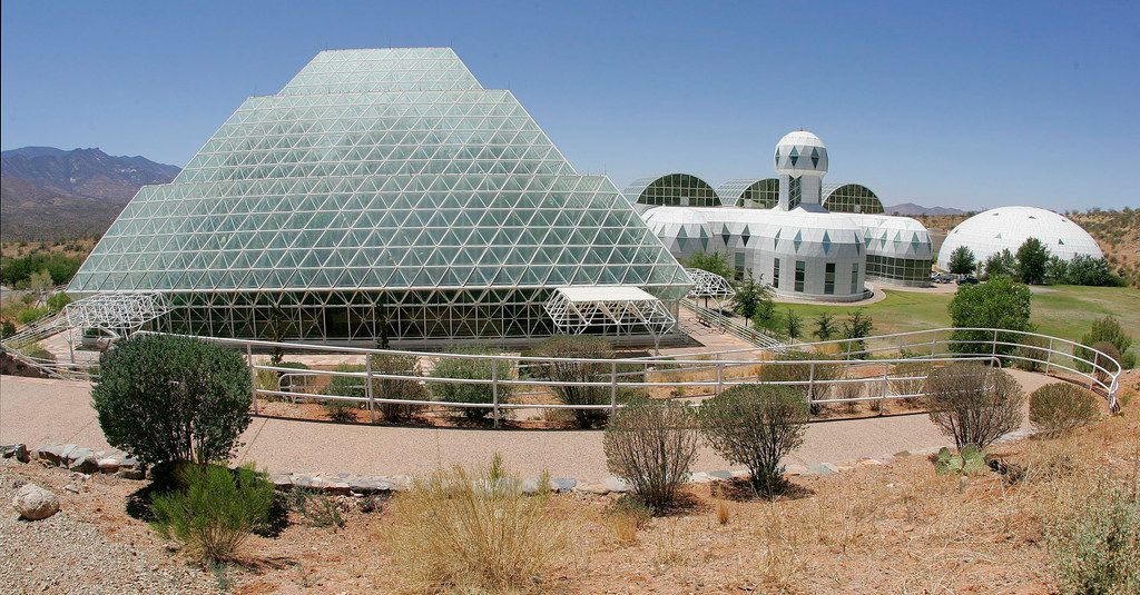 The Biosphere 2 structure in Oracle, Arizona, a scientific endeavor funded by Fort Worth's Ed Bass. Left to right are the pyramid-shaped Rainforest apparatus, the domed Habitat living quarters, and the domed West Lung (air volume control devices-far right). (Paul Moseley/Star-Telegram via AP)