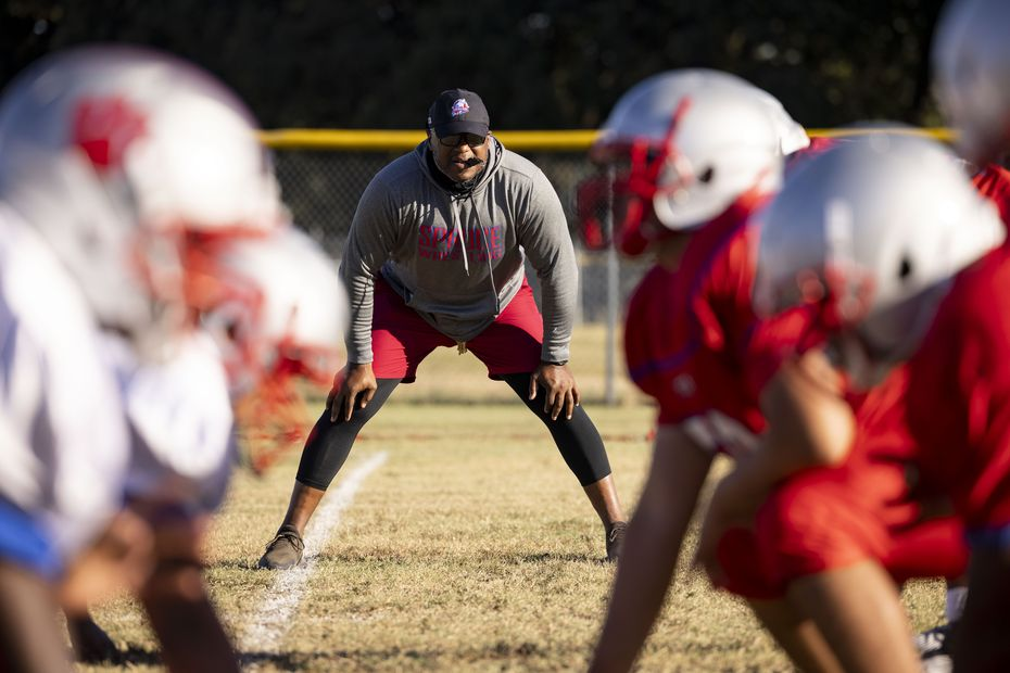Spruce High School football coach Carl Richardson Jr. watches during football practice on Wednesday, Sept. 22, 2021, at H. Grady Spruce High School in Dallas. (Juan Figueroa/The Dallas Morning News)
