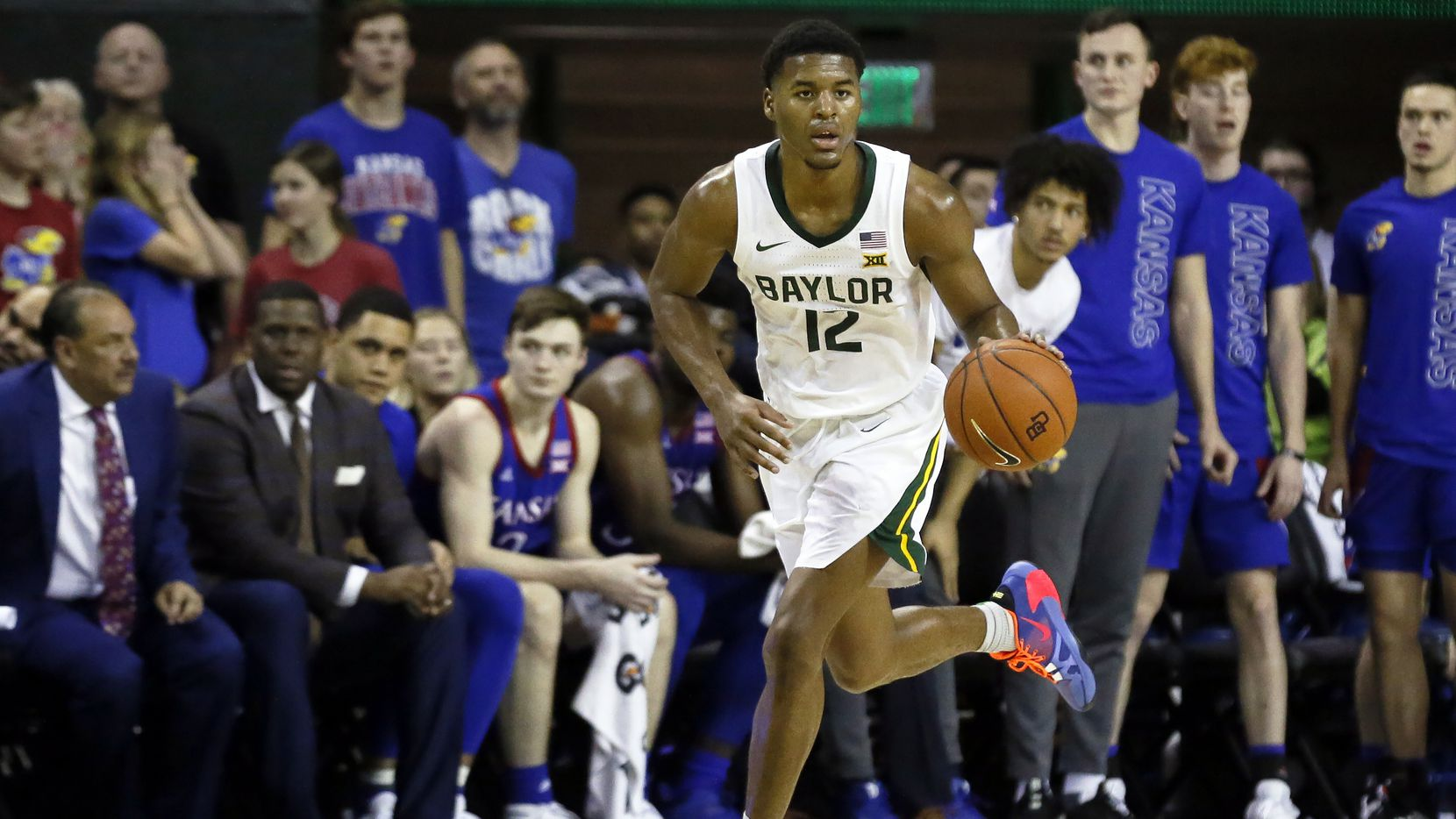 FILE - Baylor guard Jared Butler dribbles up court against Kansas during an NCAA college basketball game in Waco, Texas, in this Feb. 22, 2020, file photo. Baylor opens this season only one poll point behind top-ranked Gonzaga in in the AP Top 25.  (AP Photo/Ray Carlin, File)