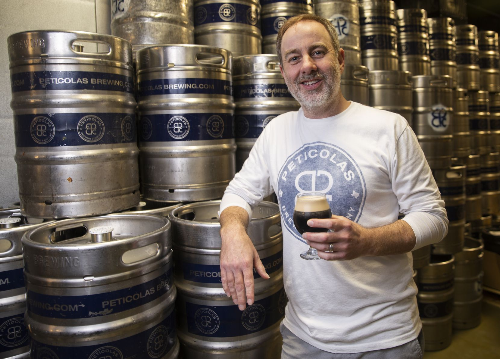 Owner Michael Peticolas poses for a photo at Peticolas Brewing Co. on Jan. 10, 2020 in Dallas. Congress extended for one year a valuable tax break last month for Texas alcohol producers like Peticolas. (Juan Figueroa/ The Dallas Morning News)