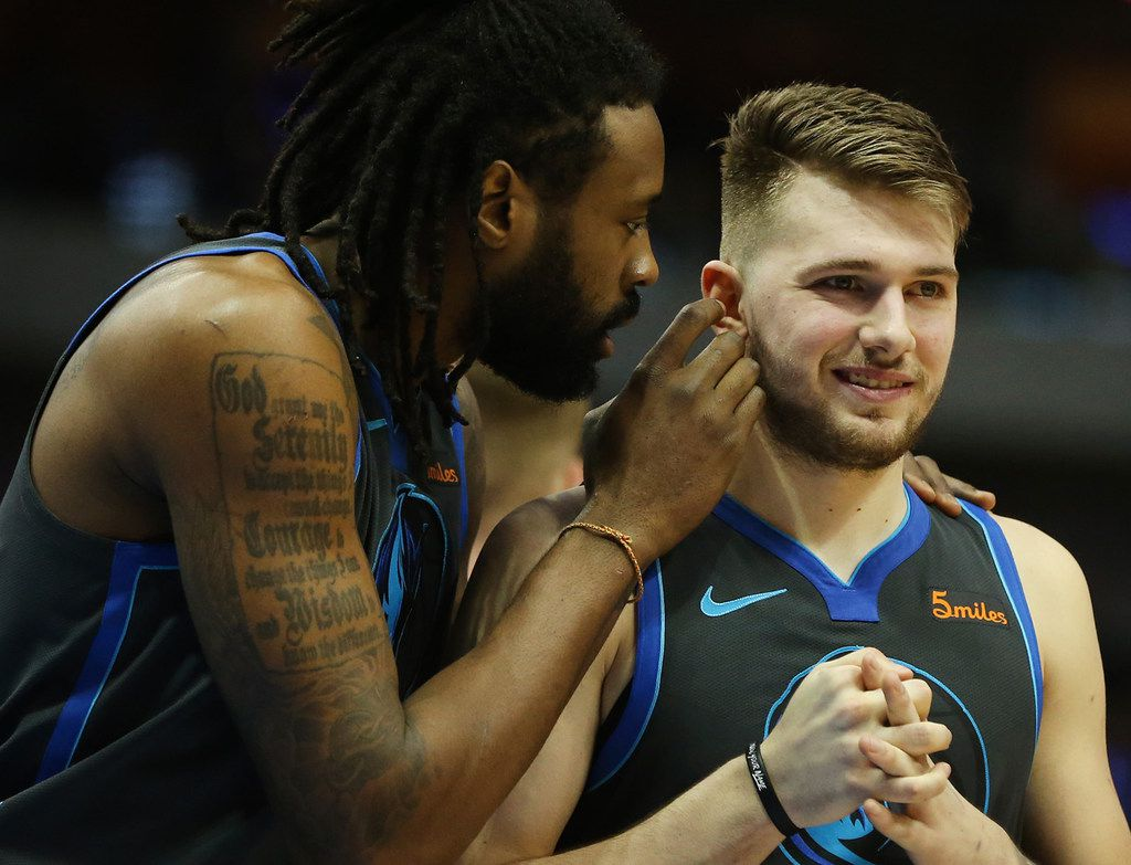 The Dallas Mavericks' DeAndre Jordan, left, whispers in the ear of teammate Luka Doncic in the fourth quarter against the San Antonio Spurs at the American Airlines Center in Dallas on Wednesday, Jan. 16, 2019. The Spurs won, 105-101. (Rose Baca/Dallas Morning News/TNS)