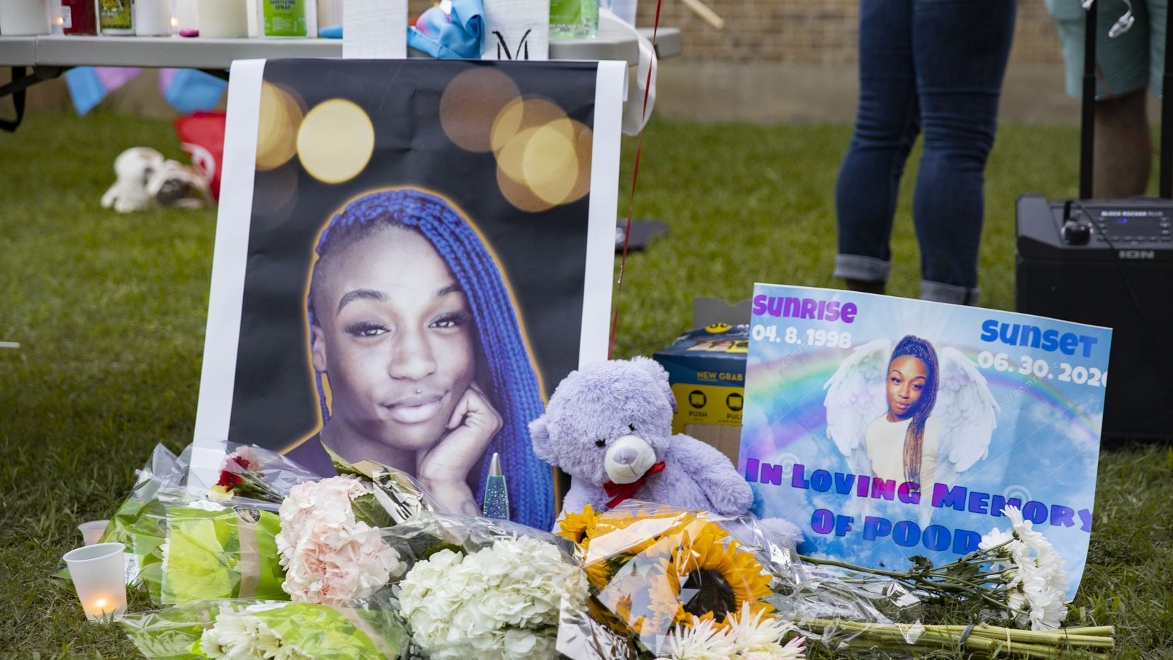 Flowers were placed near portraits of Merci Richey at a July 4 vigil for the trans woman who was killed June 30.