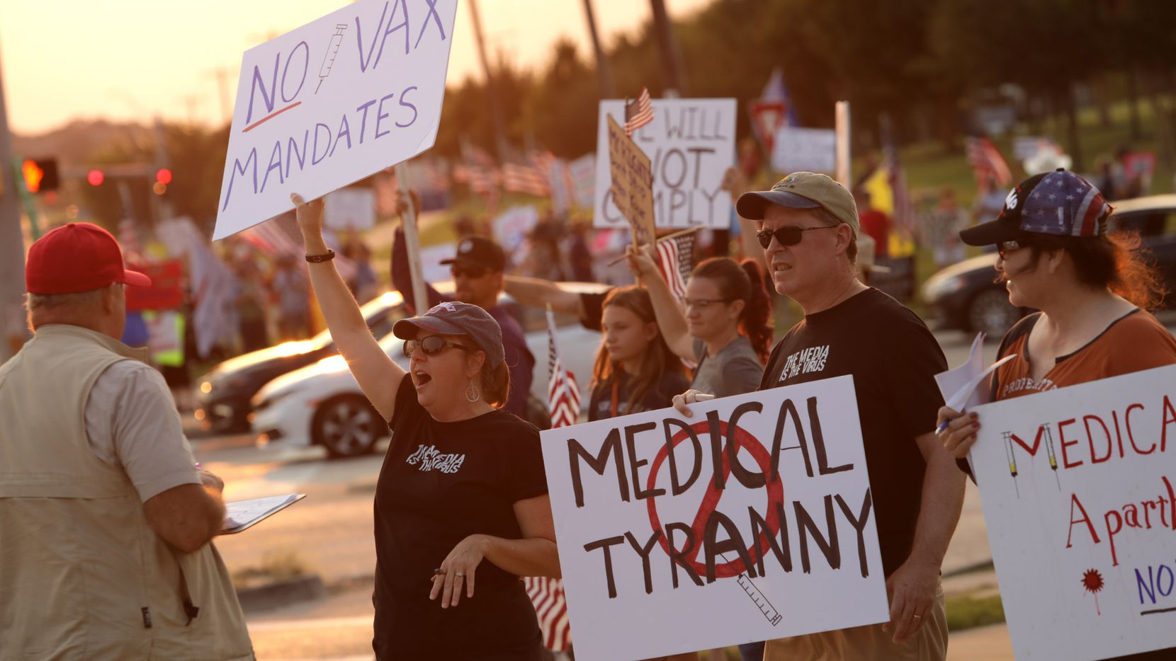 Dozens of demonstrators gathered along the road near the Baylor Scott and White hospital campus in McKinney to protest vaccine mandates on Friday, Sept. 10, 2021.