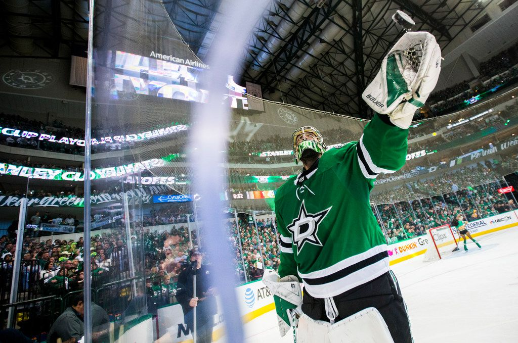 Dallas Stars goaltender Ben Bishop (30) tosses a puck to a fan during the third period of Game 3 of a playoff series between the Dallas Stars and the Nashville Predators on Monday, April 15, 2019 at American Airlines Center in Dallas. (Ashley Landis/The Dallas Morning News)