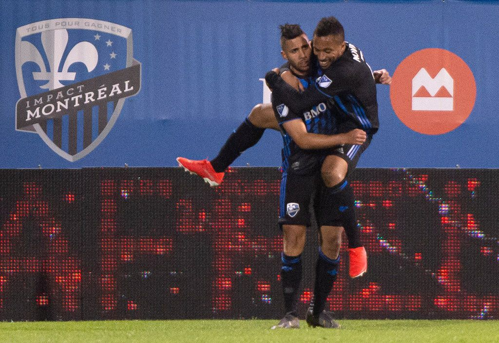 Montreal Impact midfielder Harry Novillo jumps into the arms of midfielder Saphir Taider, celebrating Taider's goal against the Seattle Sounders during the second half of an MLS soccer match Wednesday, June 5, 2019, in Montreal. (Paul Chiasson/The Canadian Press via AP)