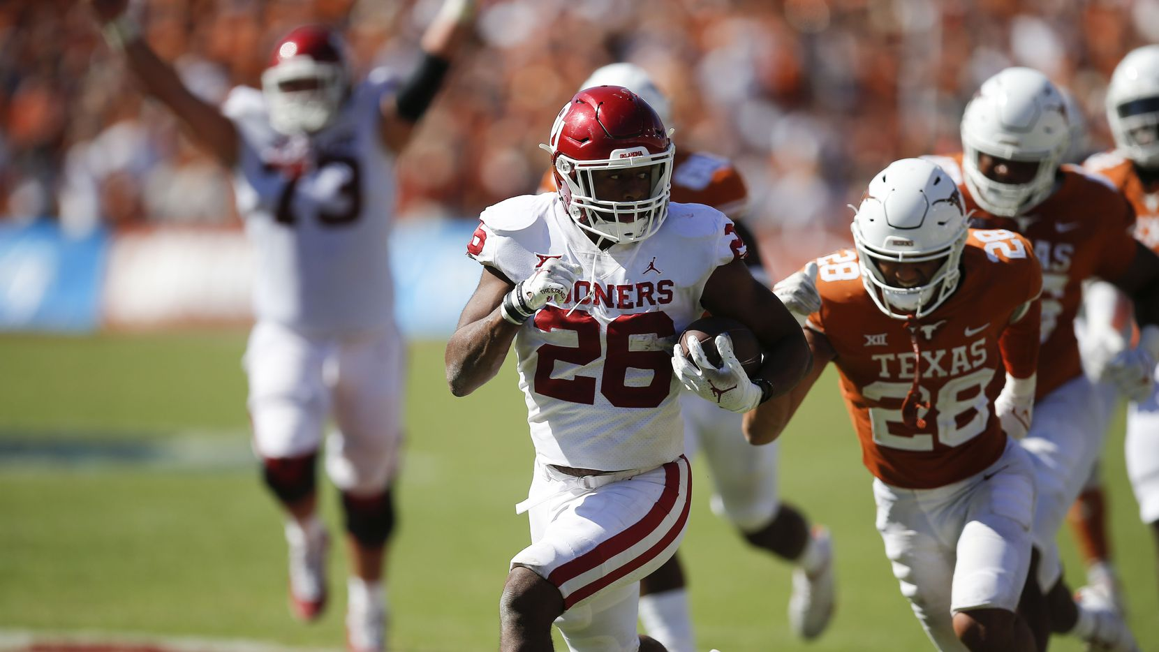 Oklahoma running back Kennedy Brooks (26) breaks past the Texas defense to score the game winning touchdown with three seconds remaining during the second half of an NCAA college football game against Texas at the Cotton Bowl in Fair Park, Saturday, October 9, 2021. Oklahoma won 55-48.