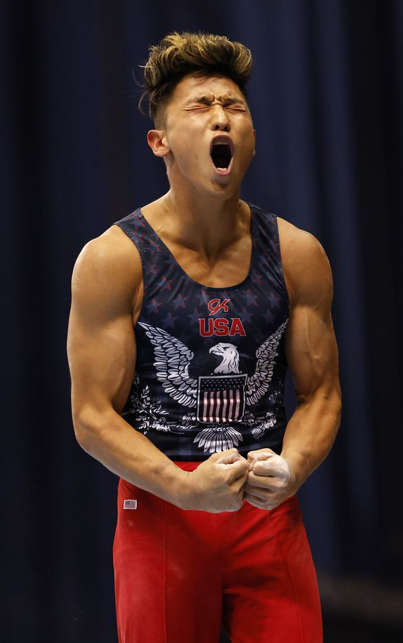 Yul Moldauer celebrates after competing in the parallel bar during day 2 of the men's 2021 U.S. Olympic Trials at America's Center on Saturday, June 26, 2021 in St Louis, Missouri.(Vernon Bryant/The Dallas Morning News)