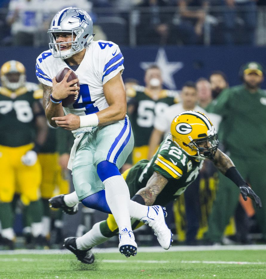 Dallas Cowboys quarterback Dak Prescott (4) escapes a tackle attempt by Green Bay Packers free safety Ha Ha Clinton-Dix (21) as he runs the ball during the third quarter of their divisional playoff game on Friday, January 15, 2017 in Arlington, Texas.