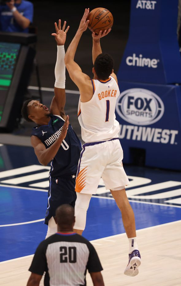 Phoenix Suns guard Devin Booker (1) shoots and makes the go ahead three pointer to win the game over Dallas Mavericks guard Josh Richardson (0) during the fourth quarter of play at American Airlines Center on Monday, February 1, 2021in Dallas. The Dallas Mavericks lost to the Phoenix Suns 109-108. (Vernon Bryant/The Dallas Morning News)
