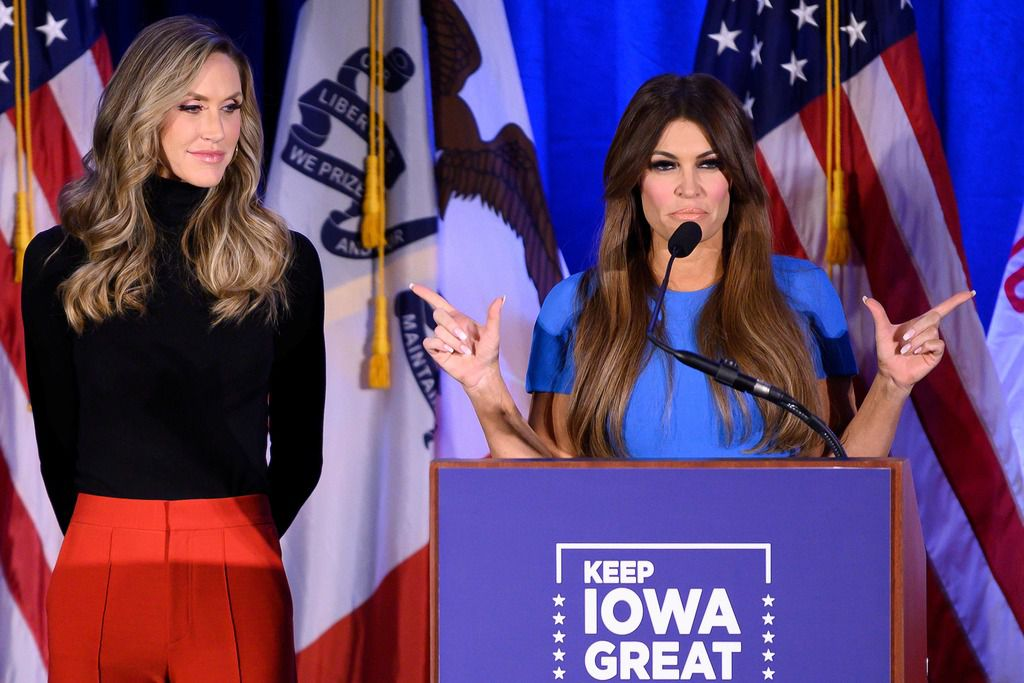 """Donald Trump Jr's girlfriend Kimberly Guilfoyle speaks with Lara Trump (L), wife of Eric Trump, during a """"Keep Iowa Great"""" press conference in Des Moines on February 3, 2020."""