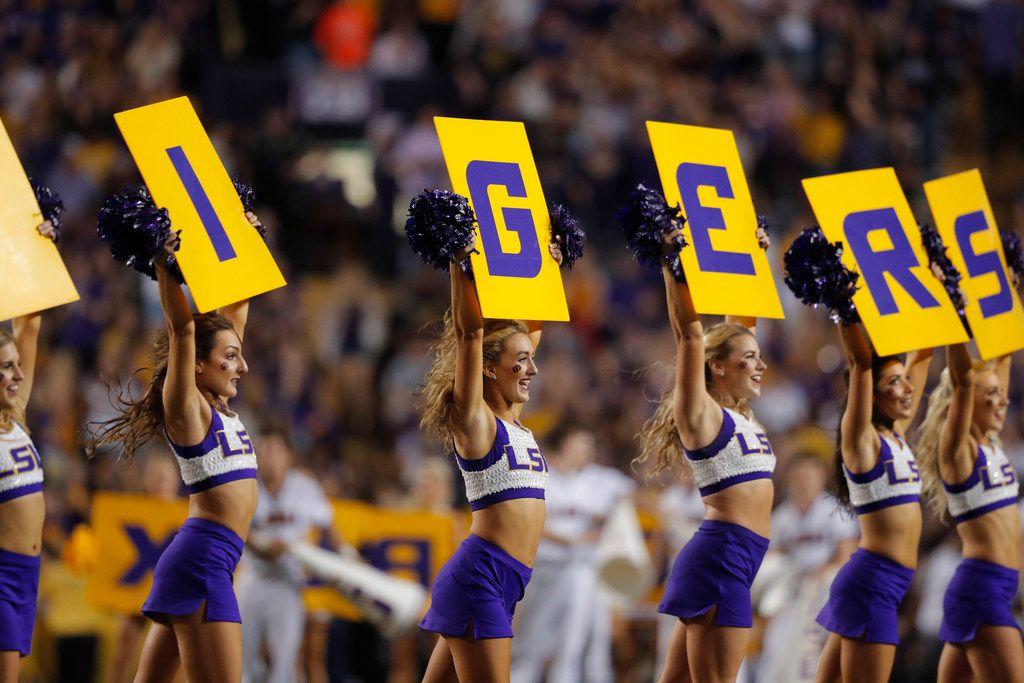 LSU cheerleaders perform in the first half of an NCAA college football game against Texas A&M in Baton Rouge, La., Saturday, Nov. 30, 2019. (AP Photo/Gerald Herbert)
