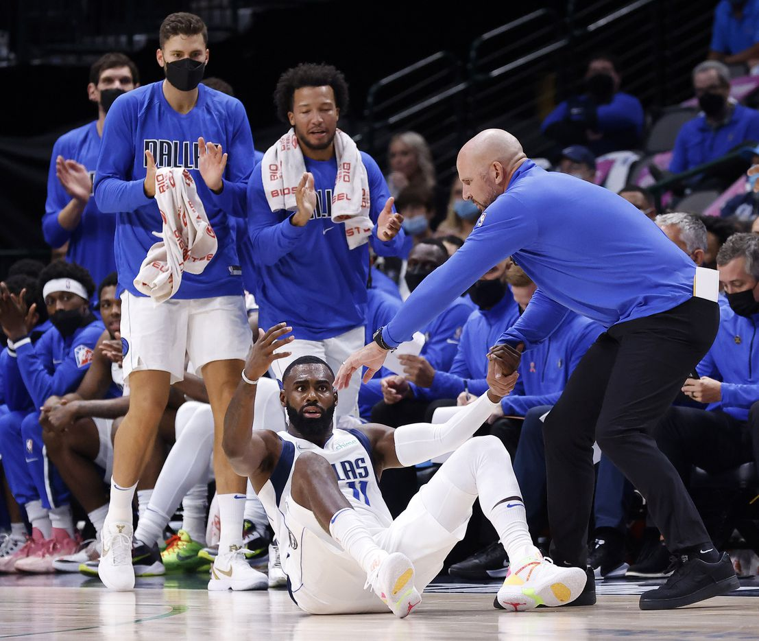 Dallas Mavericks head coach Jason Kidd gets forward Tim Hardaway Jr. (11) back on his feet after he was allegedly fouled by the Utah Jazz during the first half at the American Airlines Center in Dallas, Wednesday, October 6, 2021.(Tom Fox/The Dallas Morning News)