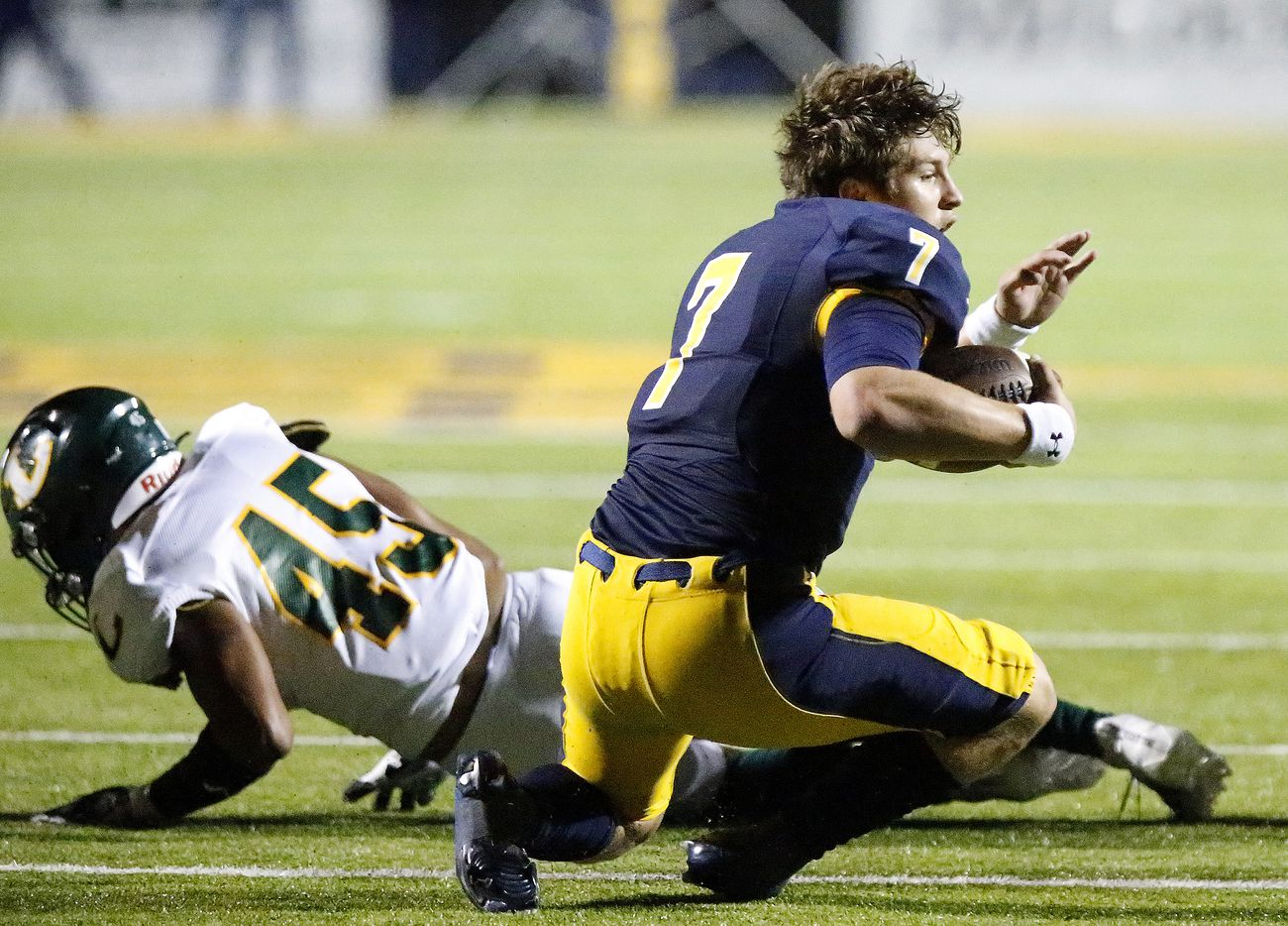Highland Park High School quarterback Brennan Storer (7) looses his helmet after a hit by Longview High School defensive lineman ROUGELY, Jeremiah Roughly (45) during the first half as Highland Park High School hosted Longview High School at Highlander Stadium in Dallas on Friday night, October 8, 2021. (Stewart F. House/Special Contributor)
