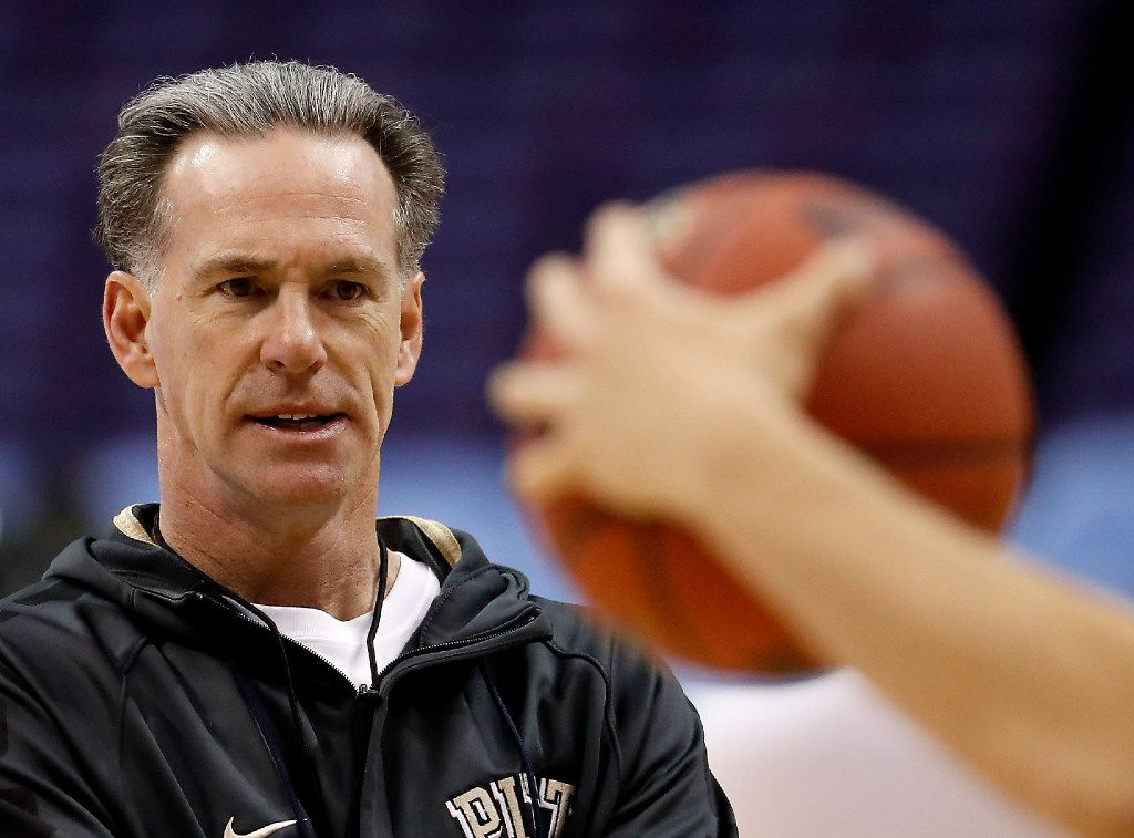 FILE - In this March 17, 2016 file photo, Pittsburgh head coach Jamie Dixon watches practice ahead of a first-round men's college basketball game in the NCAA tournament in St. Louis. Dixon was part of two Southwest Conference titles as a TCU player three decades ago. Dixon, who won 328 games the past 13 seasons at Pittsburgh, is now back at his alma mater as head coach.