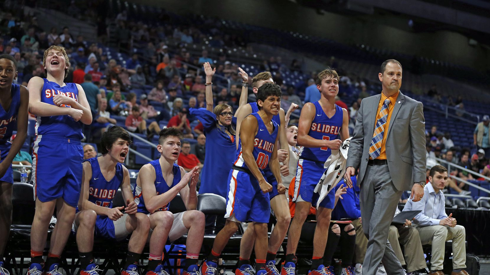 Slidell bench celebrates after a basket late in fourth quarter. Slidell defeated Jayton 45-28 in a Class 1A semifinal game on Thursday, March 12, 2020 at the Alamodome.