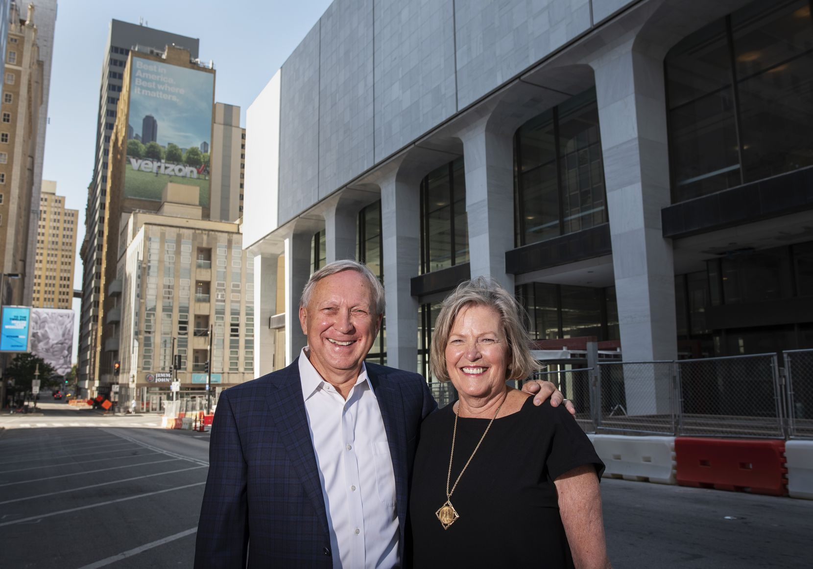 Jerry Merriman, president and founder of Merriman Anderson/Architects, and his wife, Deby Merriman, the company's director of human resources, are shown outside The National building in downtown Dallas.