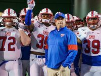 SMU head coach Sonny Dykes stands with his team before Mustangs take the field for an NCAA football game against Memphis at Liberty Bowl Memorial Stadium on Saturday, Nov. 2, 2019, in Memphis, Tenn.