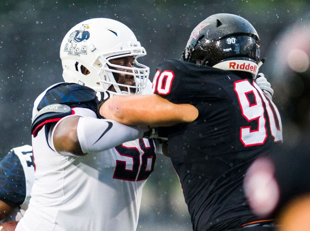 Allen offensive lineman CerTaidrian Brooks (58) squares up with Coppell defensive lineman Parker Odette (90) during the first quarter of a high school football game between Allen and Coppell on Friday, September 14, 2018 at Buddy Echols Field in Coppell, Texas.