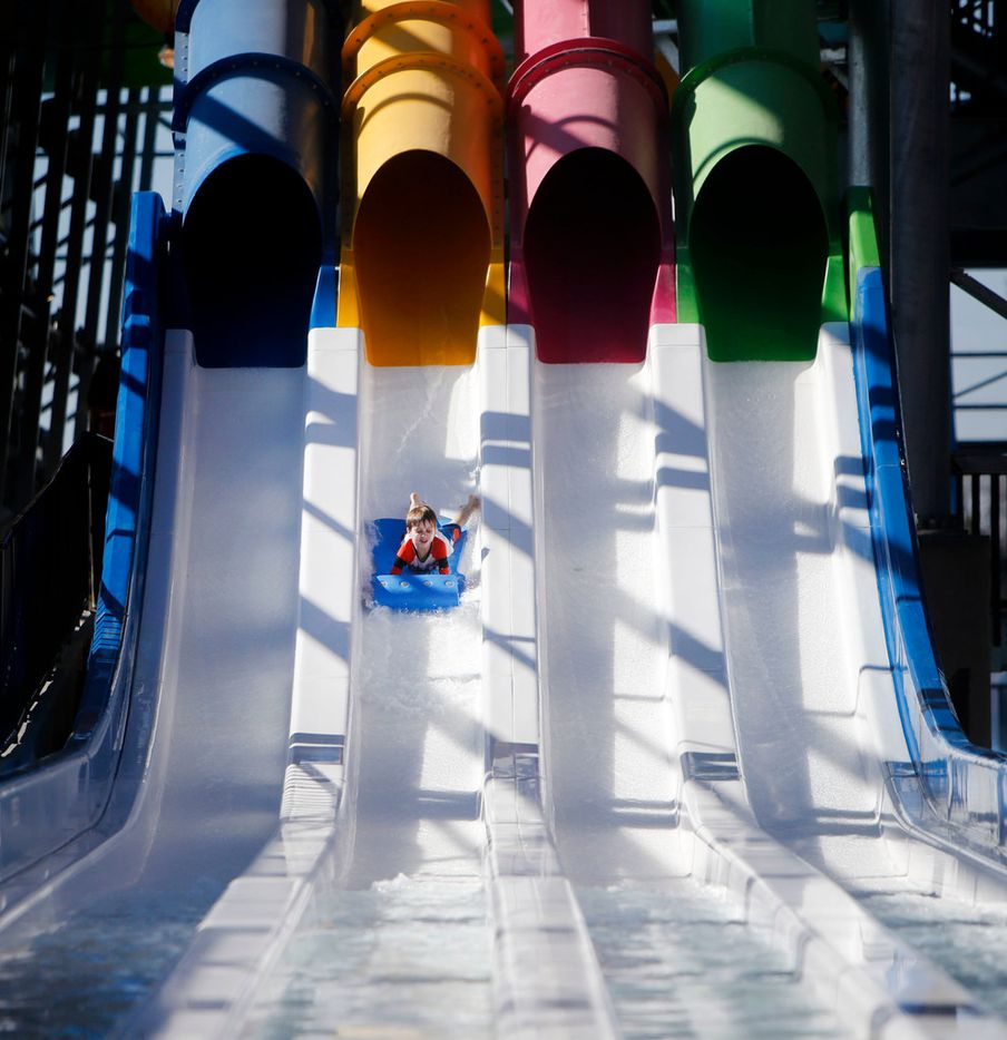 Jett Akin, 7, goes down a water slide during media day at the new Epic Waters Indoor Waterpark in Grand Prairie, Texas on Monday, Jan. 8, 2018. The city-owned waterpark is the largest in North America under a single retractable roof. (Rose Baca/The Dallas Morning News)