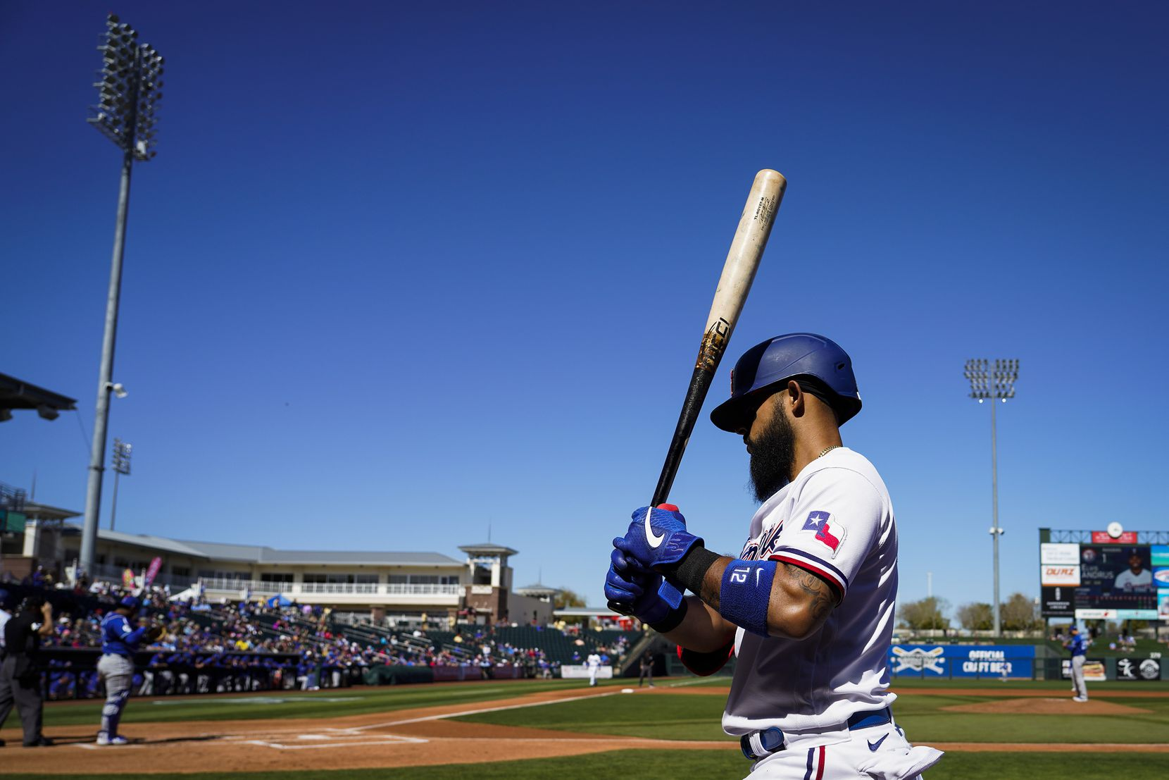 Texas Rangers second baseman Rougned Odor waits on deck during the second inning of a spring training game against the Kansas City Royals at Surprise Stadium on Tuesday, Feb. 25, 2020, in Surprise, Ariz.