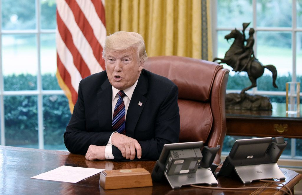 President Donald Trump talks to Mexican President Enrique Pena Nieto during a phone conversation on Monday, Aug. 27, 2018 to announce the United States-Mexico Trade Agreement in the Oval Office of the White House in Washington, D.C. (Olivier Douliery/Abaca Press/TNS)