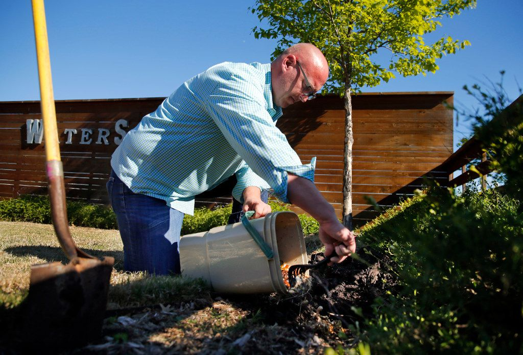After two weeks of fermentation, horticulturalist Daniel Cunningham adds part of bokashi pre-compost to a garden at the Texas AgriLife Research Center.