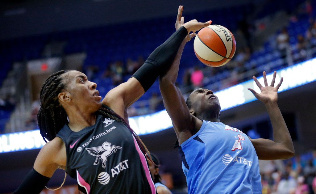 Dallas Wings forward Kayla Thornton (6) tries to get a hand on an offensive rebound from Atlanta Dream center Elizabeth Williams (1) during the third quarter at College Park Center in Arlington, Texas, Sunday, August 25, 2019. Despite their comeback in the fourth quarter, the Wings fell to the Dream, 77-73. (Tom Fox/The Dallas Morning News)