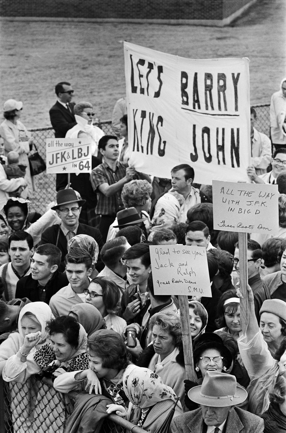 """Hate in Dallas?"" Nov. 22, 1963 -- A crowd of Grass Roots Democrats and other supporters of Pres. John F. Kennedy greeted him upon his arrival at Dallas Love Field, near opponents carrying a ""Let's Barry King John"" sign (referring to their desire to see conservative Republican Barry Goldwater become the party's nominee to run against the more liberal Democratic president Kennedy in the future 1964 presidential race which Kennedy never made it to.)"