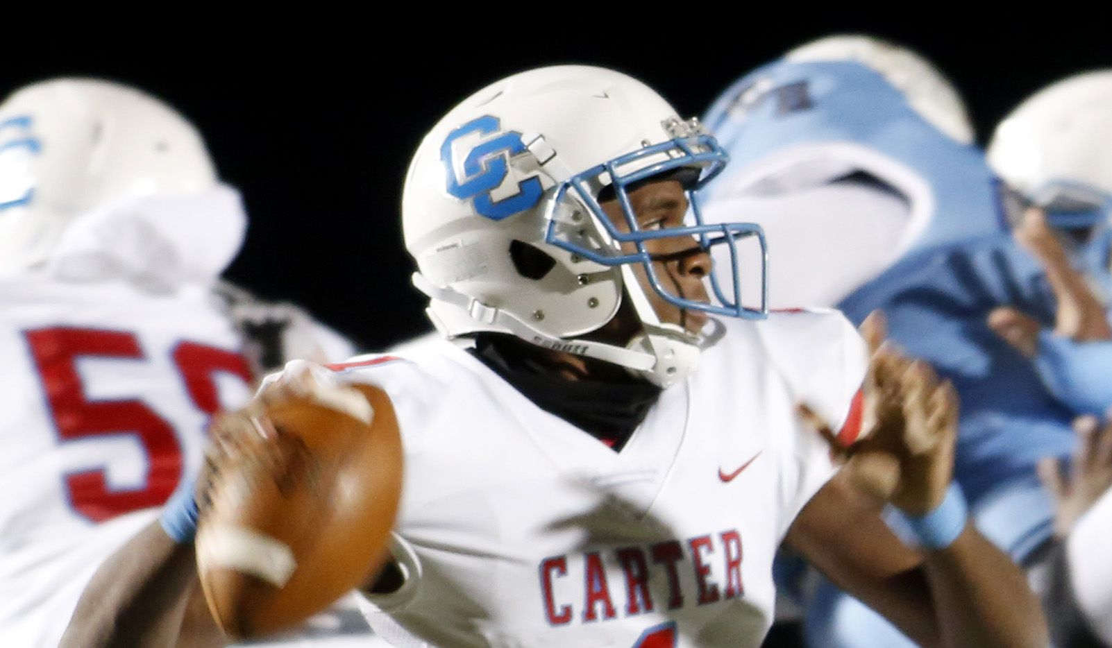 Carter quarterback Kace Williams (1) prepares to deliver a pass from the pocket during first quarter action against Wilmer Hutchins. The two teams played their District 8-4A Division 1 football game at Wilmer Hutchins High School Stadium in Dallas on October 23, 2020.