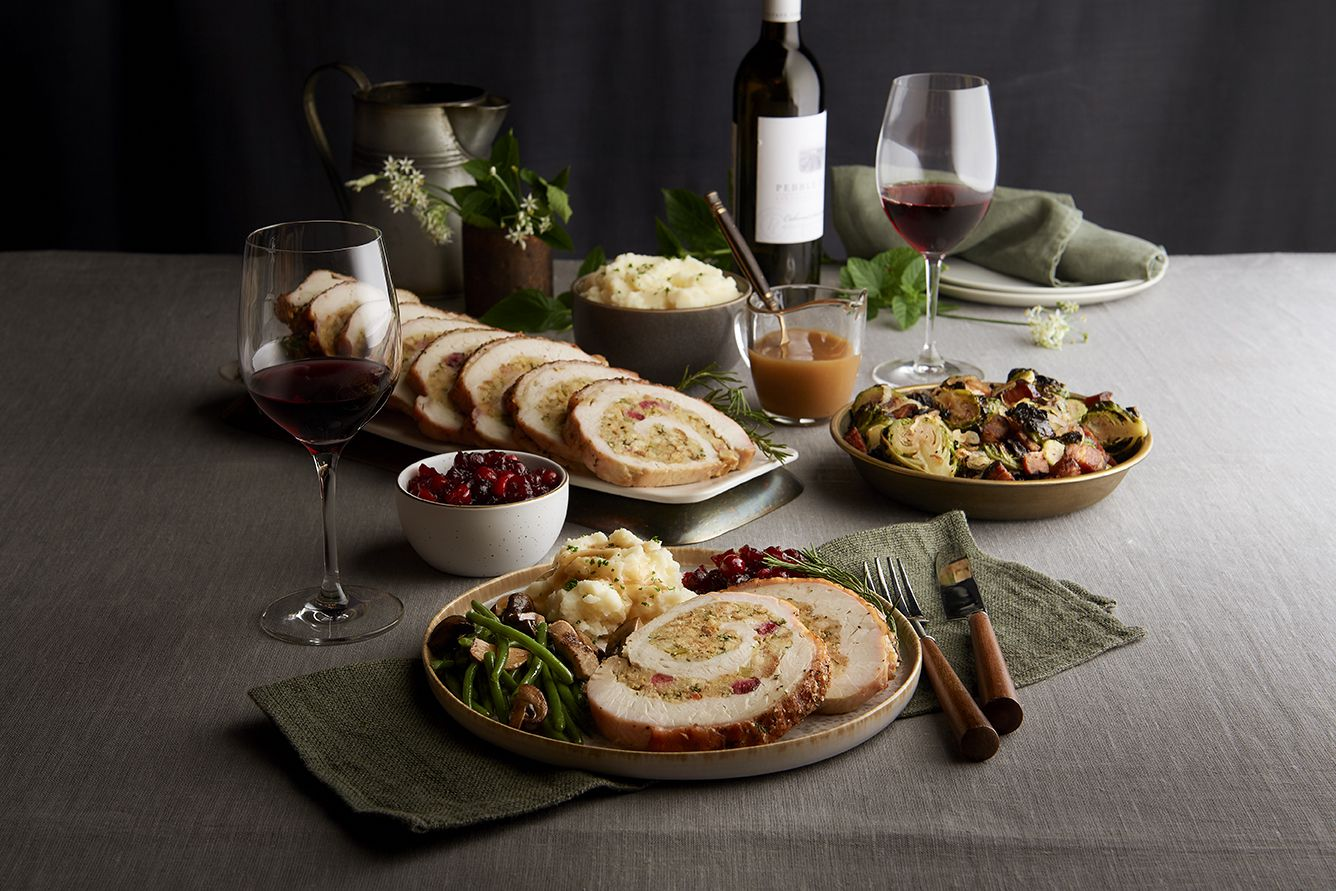 Morton's the Steakhouse's Thanksgiving 2020 takeout menu includes oven roasted turkey roulade with savory sage and cranberry stuffing, smoked gouda au gratin, Brussels sprouts, cranberry relish and turkey gravy.