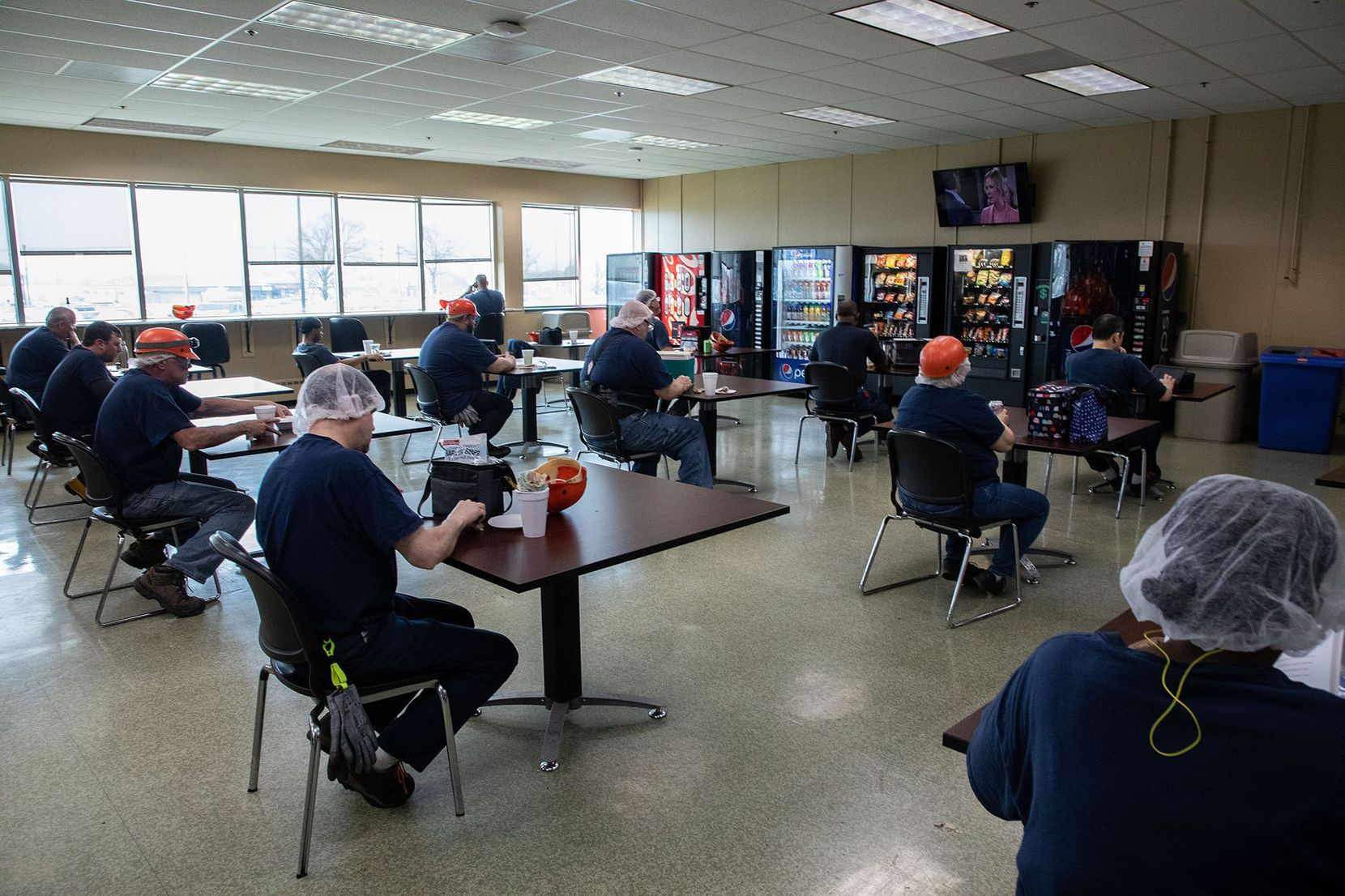Workers practice social distancing during lunch break at the Kraft Heinz manufacturing plant.