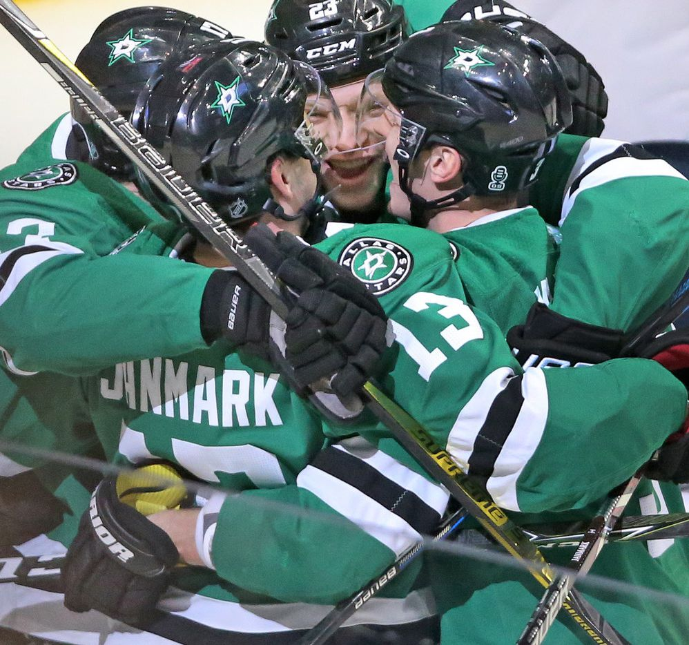 Teammates surround Dallas Stars center Mattias Janmark (13) after his third-period goal during the Florida Panthers vs. the Dallas Stars NHL hockey game at the American Airlines Center in Dallas on Tuesday, January 23, 2018. (Louis DeLuca/The Dallas Morning News)
