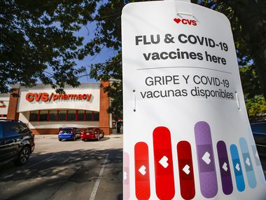 A CVS on Walnut Hill Lane in northeast Dallas advertises flu and COVID-19 vaccinations.