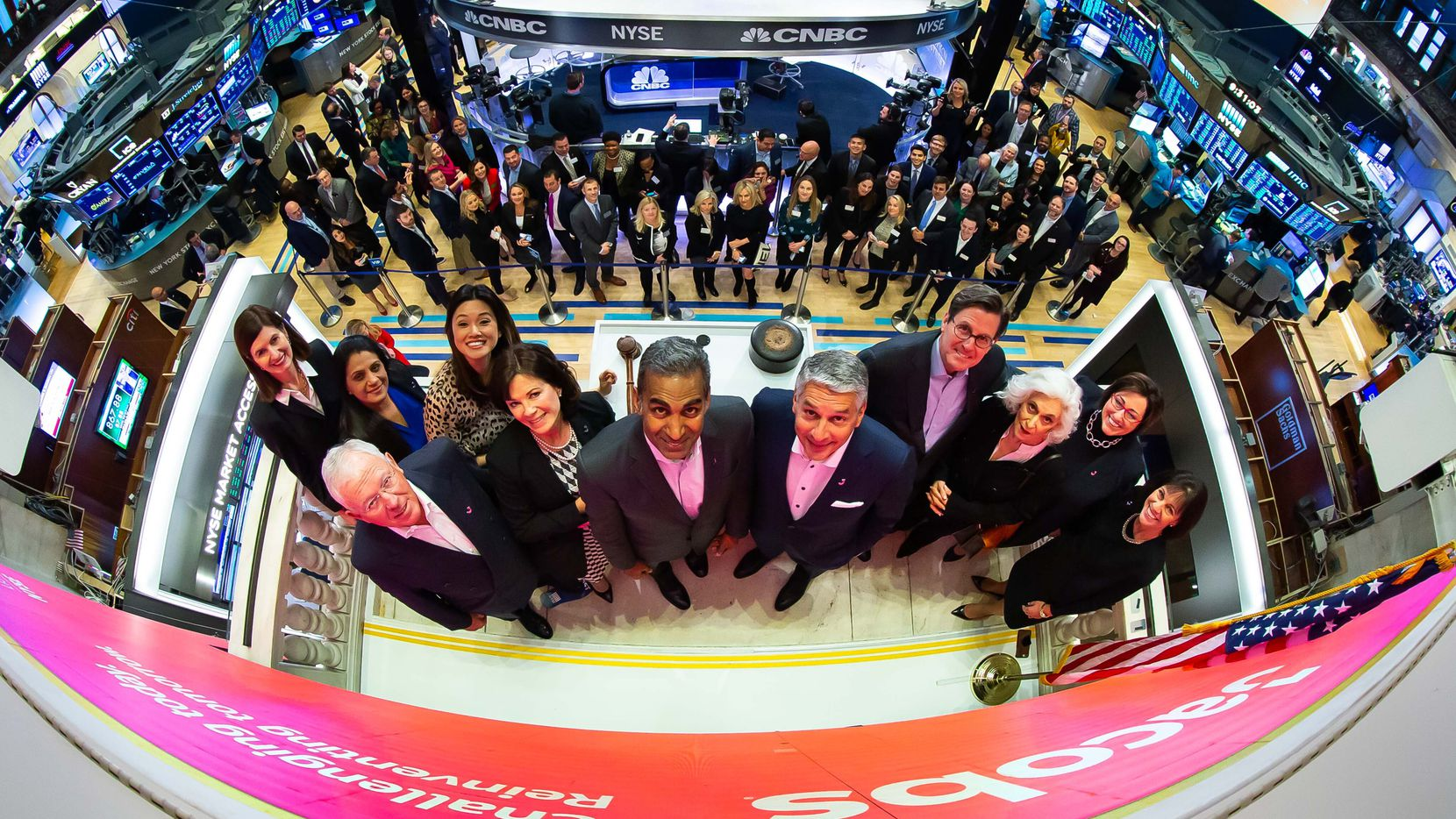 """Steve Demetriou, CEO of Jacobs Engineering Group, center right, with his leadership team, celebrated 30 years of being a public company on the New York Stock Exchange and its new ticker symbol, the single letter """"L"""" on Feb. 4, 2020. The New York Stock Exchange welcomes Jacobs (NYSE: J) in celebration of its 30th anniversary of listing, recent global brand launch, and the unique shift to a single """"J"""" ticker symbol. Chair & CEO Steve Demetriou along with fellow leaders and board members, joined by Betty Liu, NYSE Executive Vice Chairman, ring The Opening Bell  ."""