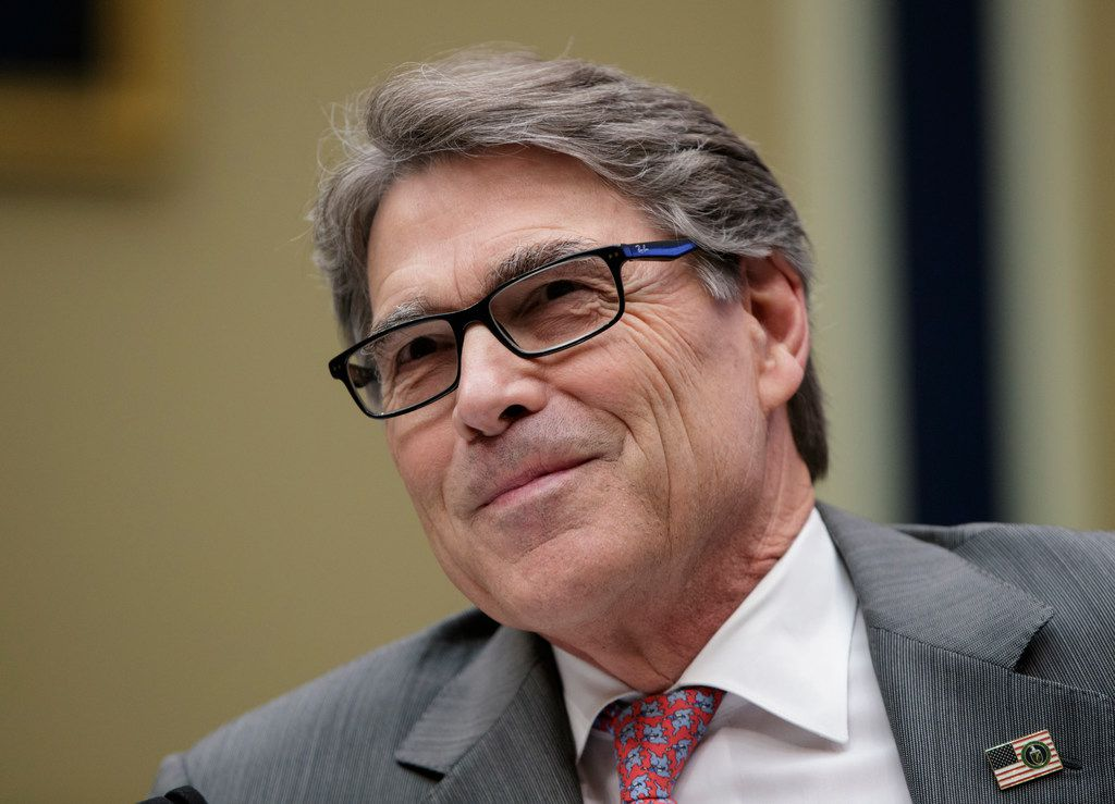 Energy Secretary Rick Perry listens to a statement by Energy and Commerce Committee Chairman Greg Walden, R-Ore., during a hearing about the electrical grid, on Capitol Hill in Washington on Thursday.