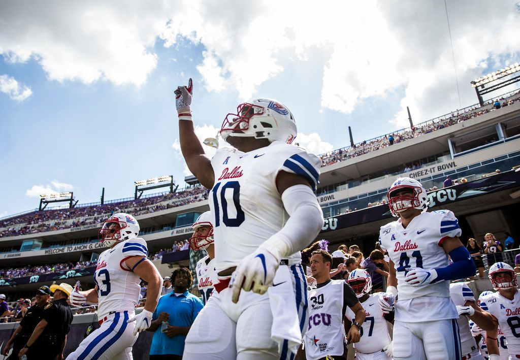 SMU players run on to the field before a college football game between SMU and TCU on Saturday, September 21, 2019 at Amon G. Carter Stadium in Fort Worth.