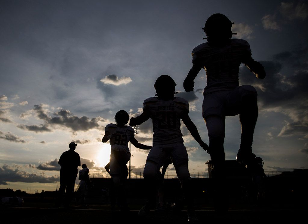 Crandall football players warm up before a 4A high school football game between Carter and Crandall on Friday, September 20, 2019 at Sprague Stadium in Dallas. (Ashley Landis/The Dallas Morning News)
