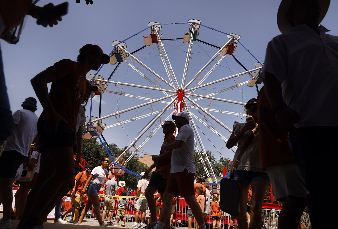 Fans ride a ferris wheel on Smokey's Midway, a mini 'state fair' outside of DKR-Texas Memorial Stadium in Austin, Saturday, September 4, 2021. The Longhorns were facing the Louisiana-Lafayette Ragin Cajuns. (Tom Fox/The Dallas Morning News)
