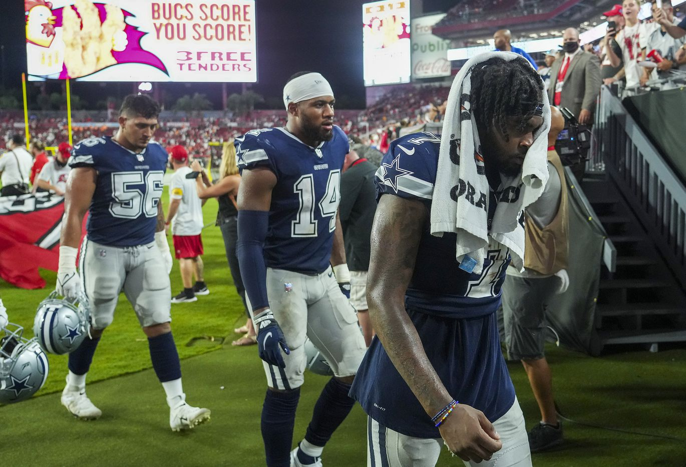 Dallas Cowboys cornerback Trevon Diggs (7), linebacker Jabril Cox (14) and defensive end Bradlee Anae (56) leave the field following a loss to the Tampa Bay Buccaneers in an NFL football game at Raymond James Stadium on Thursday, Sept. 9, 2021, in Tampa, Fla. The  Buccaneers won the game 31-29. (Smiley N. Pool/The Dallas Morning News)