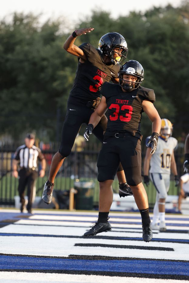 Euless Trinity running back Garry Maddox (3) celebrates his touchdown against Arlington Lamar with fullback Buddy Leota (33) during a first half of their high school football game in Bedford, Texas on Aug. 26, 2021. (Michael Ainsworth/Special Contributor)