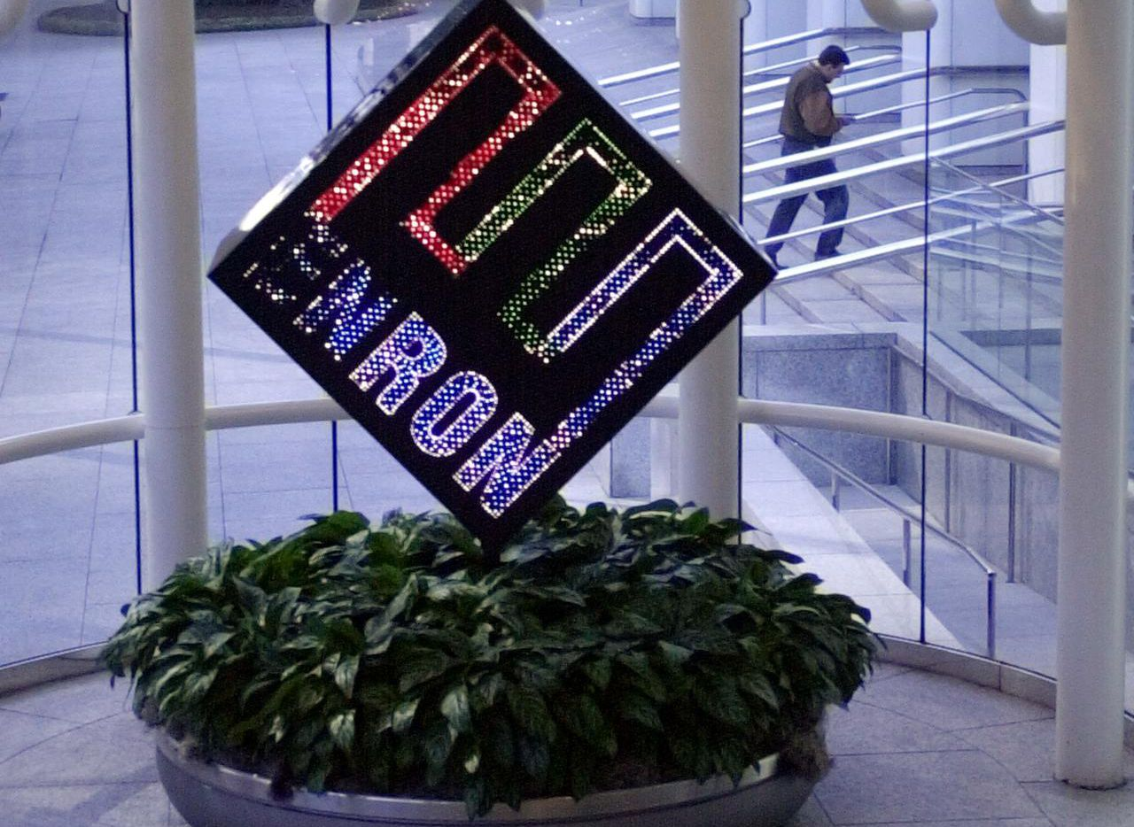 This Feb. 11, 2002 file photo shows a revolving Enron Corp. logo spinning in the lobby of the energy company's downtown Houston headquarters. It was short sellers who uncovered the accounting scandal that led to Enrol's collapse. (AP Photo/Pat Sullivan, File) 12252010xBIZ 12022011xBRIEFING