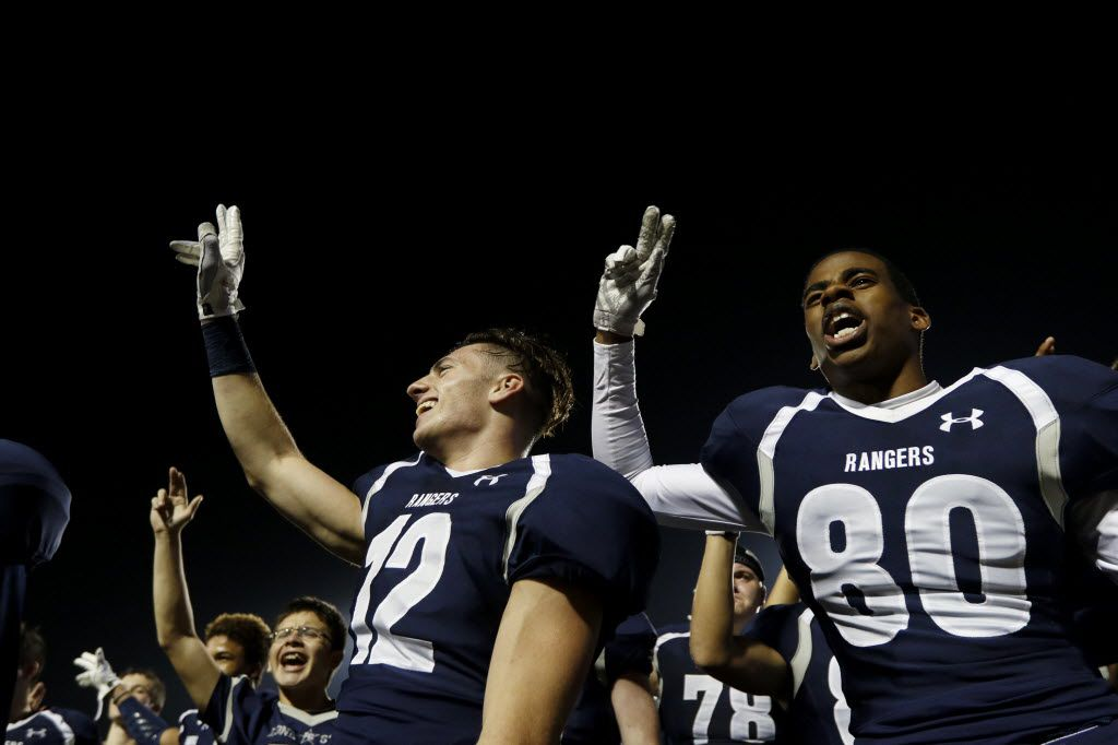 From left, Frisco Lone Star Ranger's Dakota Albrecht and  Zach Jones celebrate their win against the Lake Dallas Falcons at Eagle Stadium in Allen on Friday, Dec. 11, 2015. (Rachel Woolf/The Dallas Morning News)