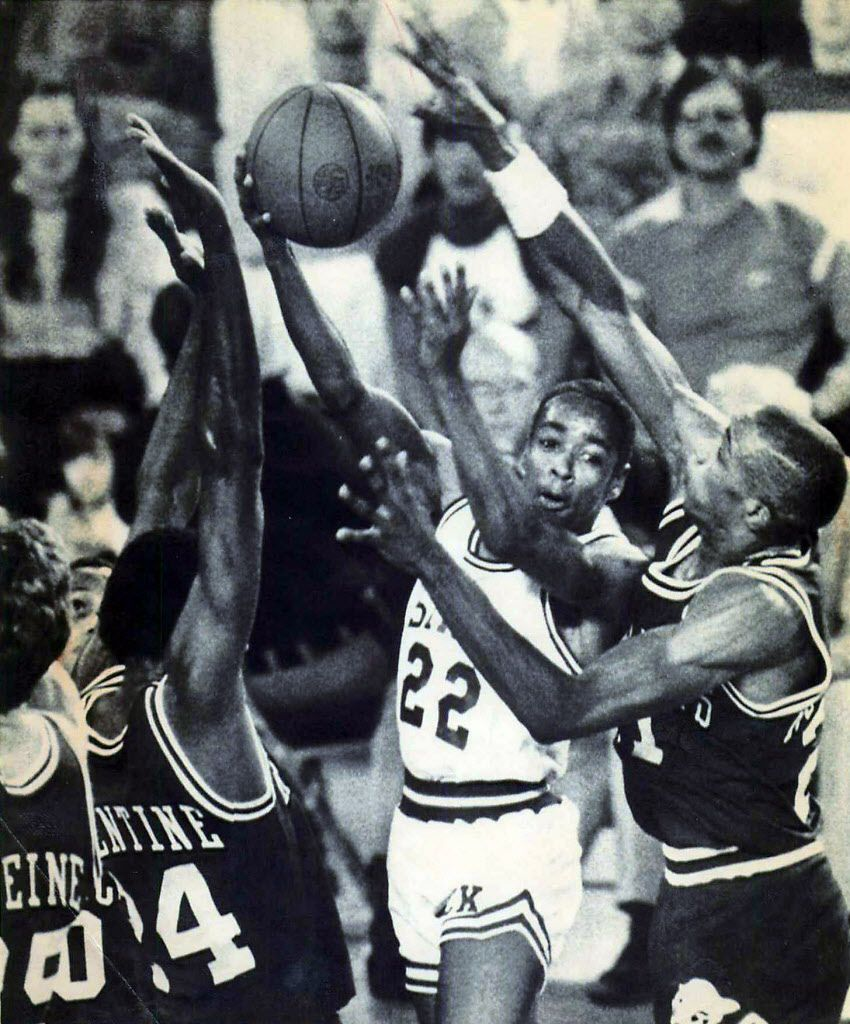 ANCHORAGE, ALASKA - November 28, 1983 - North Carolina State's Spud Webb flips the ball to a teammate despite the defensive efforts of Arkansas' Charles Balentine (left) and Alvin Robertson during the championship game of the Great Alaska Shootout Sunday in Anchorage.  Webb scored 13 points as NCSU defeated Arkansas 65-60.  AP Laserphoto