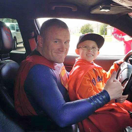 Damon Cole, a Dallas police senior corporal who owns Superman and Iron Man costumes, drove to Illinois on his own dime to help Bryce Schottel.