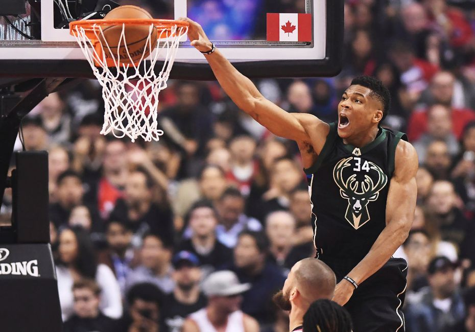 Milwaukee Bucks forward Giannis Antetokounmpo dunks against the Toronto Raptors during the first half of the opening game of an NBA basketball playoff series, in Toronto on Saturday, April 15, 2017. (Frank Gunn/The Canadian Press via AP)