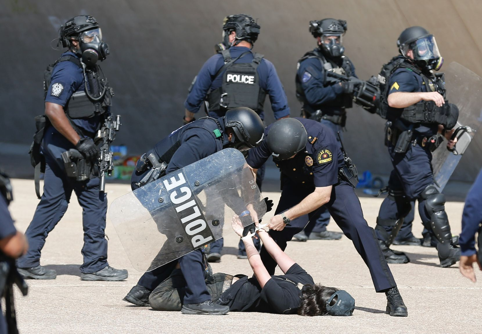 A protester is detained during a demonstration against police brutality in downtown Dallas, on Saturday, May 30, 2020. George Floyd died in police custody in Minneapolis on May 25.