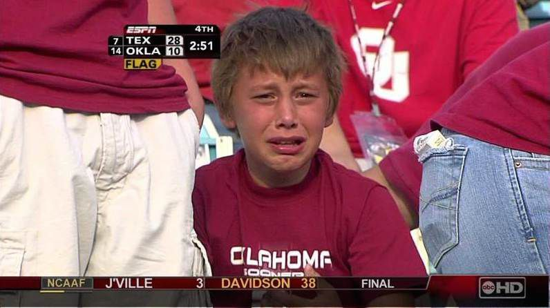 Jonah Israel, 11, weeps on camera as the Oklahoma Sooners fell to Texas 28-10 during the 2006 Red River Rivalry game at the Cotton Bowl in Dallas.